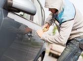 Thief breaking the car lock — Stock Photo