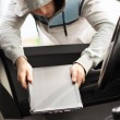 Thief stealing laptop from the car — Stock Photo