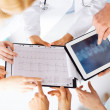 Group of doctors looking at x-ray on tablet pc — Stock Photo #30811369