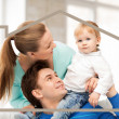 Family with child and dream house — Stock Photo #31316807
