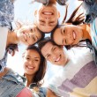 Group of teenagers looking down — Stock Photo #31317045