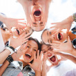 Group of teenagers looking down and screaming — Stock Photo