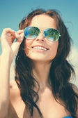 Woman in bikini and sunglasses — Stock Photo