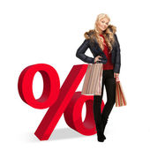 Woman with shopping bags and percent sign — Stock Photo