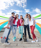 Teenagers with skates outside — Stock Photo
