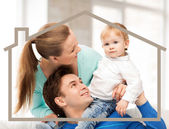 Family with child and dream house — Stock Photo