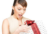 Happy woman with gift box — Stok fotoğraf