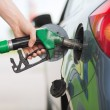 Man pumping gasoline fuel in car at gas station — Stock Photo #31489587