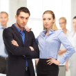Businessman and businesswoman in the front of team — Stock Photo #31496149