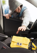 Thief stealing bag from the car — Stock Photo