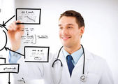 Young doctor working with something imaginary — Stock Photo