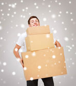 Young man carrying carton boxes — Stock Photo