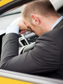 Tired businessman or taxi car driver — Stockfoto