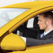 Businessman or taxi driver driving a car — Stock Photo