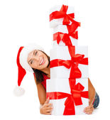 Smiling woman in santa helper hat with gift boxes — Foto de Stock