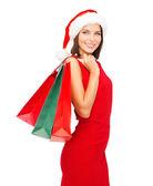 Mujer con vestido rojo con bolsas de compras — Foto de Stock