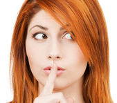 Woman with finger on her lips — Stock Photo
