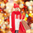 tienermeisje in winterkleren met shopping tassen — Stockfoto