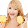 Happy girl with pineapple — Stock Photo #31645765