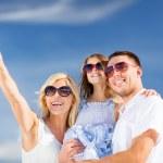 Happy family with blue sky — Stock Photo #31646825
