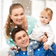 Happy parents playing with adorable baby — Stock Photo #31647173