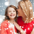 Mother and daughter cuddling — Stock Photo