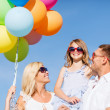Family with colorful balloons — Stock Photo #31648805