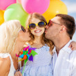 Family with colorful balloons — Stock Photo #31649011
