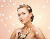 Woman wearing pearl statement necklace — Stock Photo