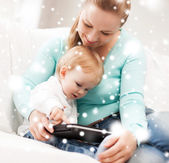 Mother and adorable baby with tablet pc — Stock Photo