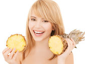 Happy girl with pineapple — Stock Photo