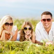 Stock Photo: Happy family with blue sky and green grass