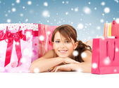 Happy girl with shopping or gift bags — Stock Photo