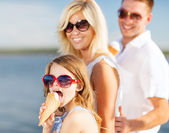 Happy family eating ice cream — Stock Photo