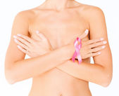 Naked woman with breast cancer awareness ribbon — Stock Photo