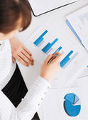 Woman hand with charts and papers — Stock Photo