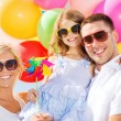 Family with colorful balloons — Stock Photo #31660245