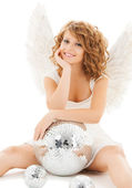 Happy teenage angel girl with disco ball — Stock Photo