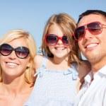 Happy family with blue sky — Stock Photo
