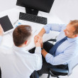 Businessmen shaking hands in office — Stock Photo #31705527