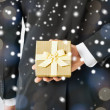 Man hiding gift box — Stock Photo