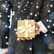 Stock Photo: Man hiding gift box