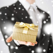 Man giving gift box — Stock Photo #31708047