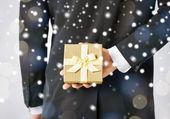 Man hiding gift box — Stock Photo