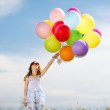 Happy girl with colorful balloons — Stock Photo #31711559