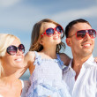 Happy family with blue sky — Stock Photo #31712963