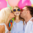 Family with colorful balloons — Stock Photo #31713371