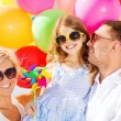 Family with colorful balloons — Stock fotografie