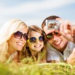 Happy family with camera taking picture — Stock Photo #31713511