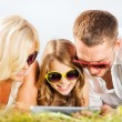 Happy family with tablet pc taking picture — Stock Photo #31714365